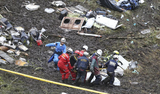 Forces work to clean plane wreckage.