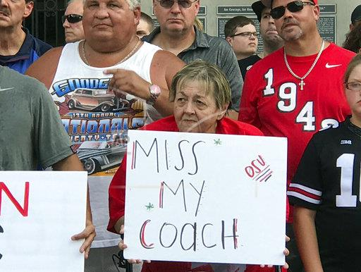 Ohio State fans rally outside Ohio Stadium to protest Meyer's paid leave.
