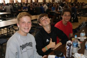 A group of freshman boys pose for a picture in the high school cafeteria