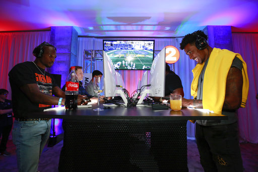IMAGE DISTRIBUTED FOR EA SPORTS MADDEN NFL 18 - Longshot stars Chad Johnson, Scott Porter, and JR Lemon square off against Brooklyn Nets Rondae Hollis-Jefferson's team in the MUT Squads Tournament at the Madden NFL 18 Launch Event held Thursday, Aug 24, 2017 in New York City. Madden NFL 18 is available Friday, August 25. (Mark Von Holden/AP Images for EA SPORTS Madden NFL 18)