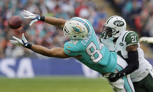 Dolphins tight end Jordan Cameron leaping for a catch against Jets safety Marcus Gilchrist in the first meeting of the season between the two teams in London, October 2015.