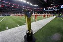 A  College Football Playoff National Championship Trophy is seen on the field before the Cotton Bowl NCAA college football semifinal playoff game between Alabama and Michigan State, Thursday, Dec. 31, 2015, in Arlington, Texas. (AP Photo/Tony Gutierrez)