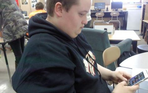 Brandon playing on his phone while in class.