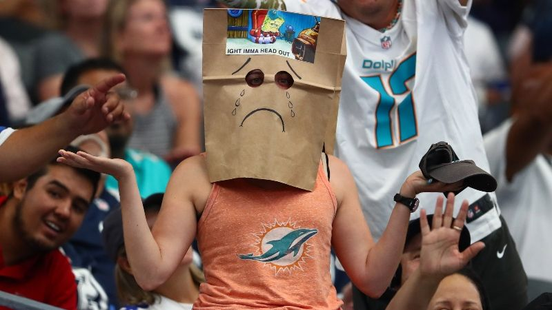 A Dolphins fan after another blowout loss. The Dolphins seem to be tanking in order to get a higher pick in next years draft.