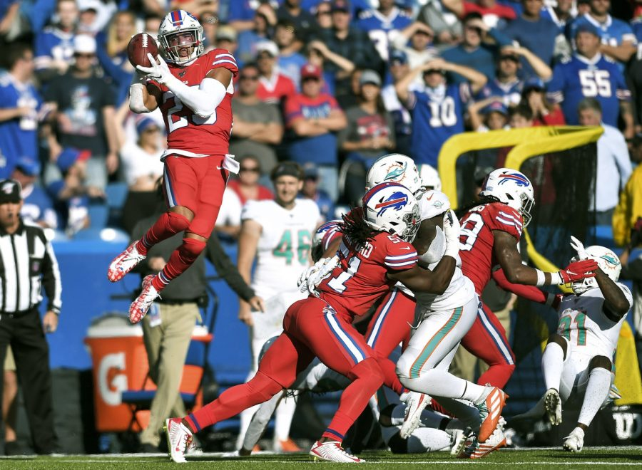 Bills+Safety+Micah+Hyde+recovers+an+onside+kick+to+seal+the+win+against+the+Dolphins.+Hyde+returned+this+flying+recovery+for+a+touchdown.