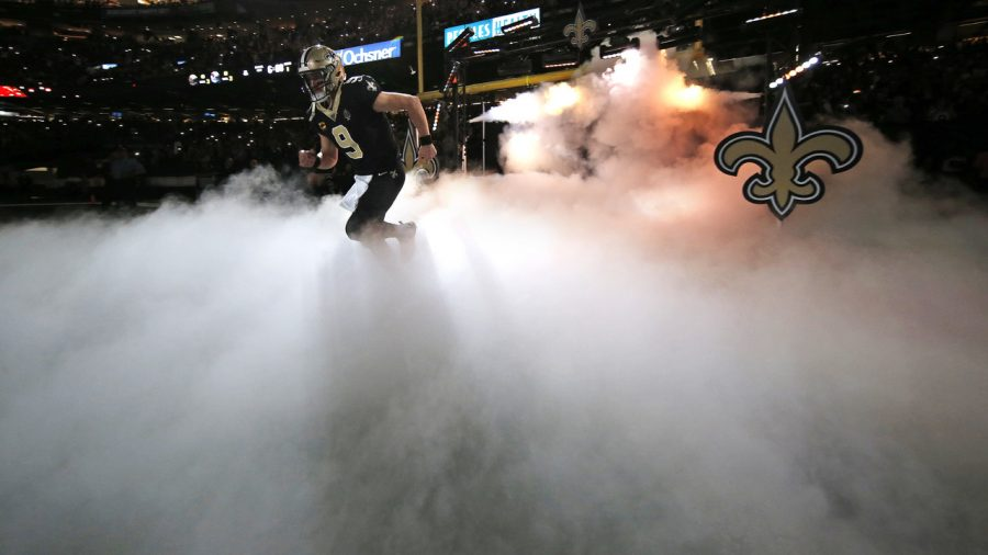 Saints+QB+Drew+Brees+emerging+from+the+smoke+to+play+his+first+game+since+week+two.